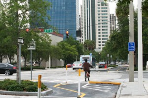 Most cyclists treat the red lights as yield signs.