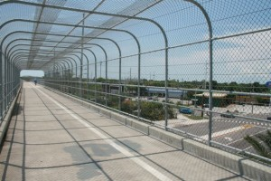 The Pinellas Trail runs north-south through the suburban and commercial corridors of St Pete, Clearwater, Duneden and Tarpon Springs. Potential conflicts have been nicely mitigated with specacular skyways that span several hundred yards over arterial roads and busy commercial areas.