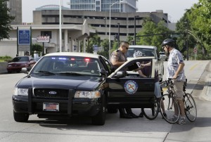 Bicyclist explains 316.2065(5)(a)(3) to FHP trooper after he pulled over a lawfully-riding group. Bike to Work Day, May 2010.